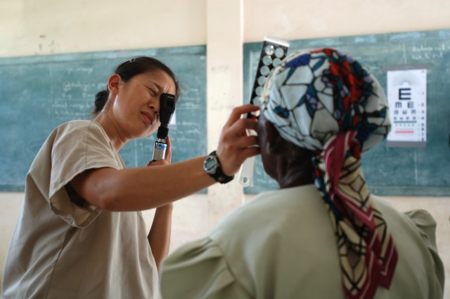 Air Force Capt. Ivy Madson, an optometrist with 56th Medical Group, conducts an eye exam for a local patient at the U.S. Army South New Horizons- Haiti 2010 Ennery medical assistance site July 13. New Horizons, in partnership with the government of Haiti, is conducting various medical, dental and engineering missions for the locals in Gonaives. New Horizons also provides valuable learning experience in a real-world environment for our U.S. Forces. (U.S. Army Photo by Spc. Jessica M. Lopez/Released)