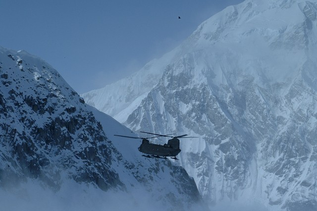 A CH-47 Chinook helicopter from Fort Wainwright's B Company, 1st Battalion, 52nd Aviation Regiment, flies along Mount McKinley on a mission. The unit recently transported a climber from the base camp at 14,000 feet when he began acting in a strange manner.