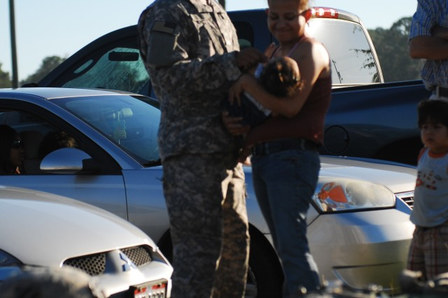 Specialist Rafael Gonzalez, a mechanic assigned to Headquarters and Headquarters Company, 4-3 Brigade Special Troops Battalion, 3rd Infantry Division, says his goodbyes to his wife Maria and their 5-month-old daughter, Scarlett, before the unit's deployment to Iraq, July 5.