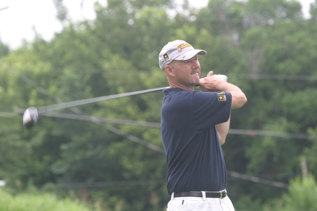 Garrison Command Sgt. Maj. Ian Mann watches his drive on the tenth hole July 8 at Rolling Meadows Golf Club.