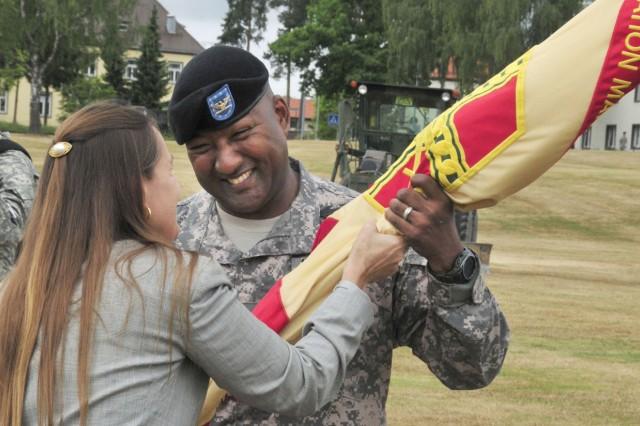 GRAFENWOEHR, Germany Aca,!aEURc Diane Devens, director of Installation Management Command-Europe, passes the guidon for U.S. Army Garrison Grafenwoehr to incoming commander Col. Vann Smiley, July 15.