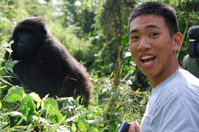 Class of 2012 Cadet Brian Tsien visits with a member the Agashya gorilla group in Volcanoes National Park. Rwanda is home to approximately two-thirds of the world's remaining mountain gorillas and they are a tremendous source of national pride.