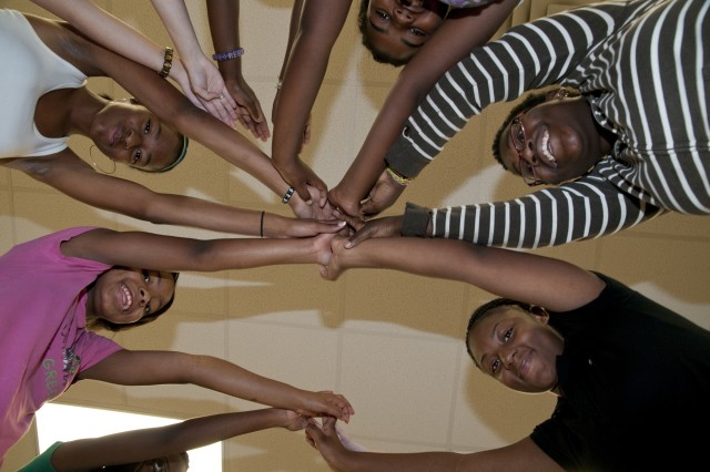 Clockwise from left: Ladasha Monroe, 13, Sierra Edwards, 13, Nikia Hill, 11, Raechel Brunson, 12 and Nadiyah Burge, 14, form a tent with other participants at the summer acting academy at Albritton Junior High School Monday. The games were both an icebreaker and a way for Raqi Barnett, instructor, to see which student had personality, creativity, leadership and cooperation skills.