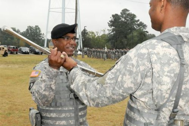Command Sgt. Maj. James Sims, 49th Quartermaster Group command sergeant major, handed the noncommissioned officer ceremonial sword over to Command Sgt. Maj. Edward L. Johnson, the incoming 530th CSSB CSM, who goes by the call sign of Warrior 7.