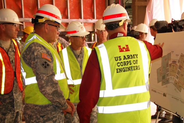 """(L-R) Command Sgt. Maj. Ronald T. Riling, FORSCOM command sergeant major, General James D. Thurman, commanding general, U.S. Army Forces Command, and Lt. Gen. Frank G. Helmick, commanding general, XVIII Airborne Corps and Fort Bragg are briefed by Ted Kientz, FORSCOM Liaison team leader, on features of the FORSCOM/U.S. Army Reserve Command combined headquarters under construction at Fort Bragg, N.C., July 15, 2010.  """""""