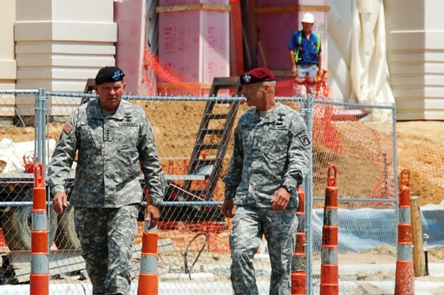 """(L-R)  General James D. Thurman, commanding general, U.S. Army Forces Command and Lt. Gen. Frank G. Helmick, commanding general, XVIII Airborne Corps and Fort Bragg, leave the site of the new FORSCOM/U.S. Army Reserve Command combined headquarters construction project at Fort Bragg, N.C., following a tour of the complex, July 15, 2010.  FORSCOM and USARC are relocating from Fort McPherson, Ga., which is scheduled for closure not later than Sept. 15, 2011 under the provisions of the Base Realignment and Closure legislation of 2005."""""""