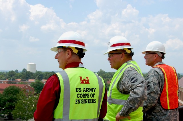 """(L-R) Ted Kientz, U.S. Army Forces Command (FORSCOM) Liaison Team leader, Gen. James D. Thurman, FORSCOM commanding general and Command Sgt. Maj. Ronald T. Riling, FORSCOM command sergeant major, view landmarks from the 5th floor overlook of the FORSCOM/U.S. Army Reserve Command combined headquarters construction project at Fort Bragg, N.C., July 15, 2010.  This was Thurman and Riling's first visit to the post since assuming their duties as FORSCOM's commanding general and command sergeant major.  """""""