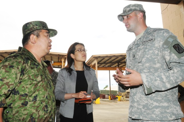 SCHOFIELD BARRACKS, Hawaii - 1st Lt. Grant Carter, Maintenance Control Officer, 536th Maintenance Company, briefs Col. (P) Katsuki Takata, Chief, Logistics Management Division, Japanese Ground Self Defense Force, on the maintenance and logistics support provided by the 536th during Takata's visit July 13. Takata was a key participant in the annual Bilateral Logistics Staff Talks with the U.S. Army, Pacific's G4 Logistics Directorate to discuss ongoing logistics cooperation and future humanitarian assistance and disaster relief operations.