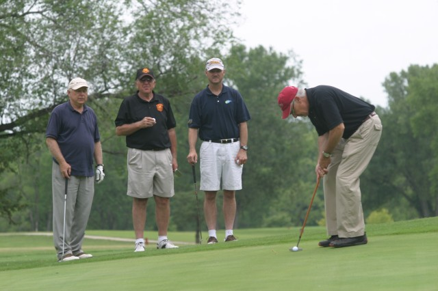 Mark Edwards, a Junction City lawyer, putts while teammates Jack Taylor, Junction City commissioner; Larry Githerman, Director of Logistics; and Garrison Command Sgt. Maj. Ian Mann watch July 8 at Rolling Meadows Golf Course.