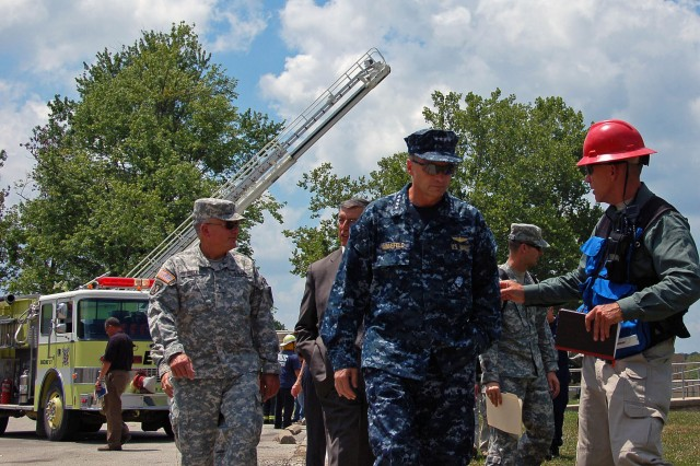 MUSCATATUCK URBAN TRAINING CENTER, Ind. - Adm. James Winnefeld Jr., commander of North American Aerospace Defense Command and U.S. Northern Command, visits the Muscatatuck Urban Training Center in Butlerville, Ind., July 16 to observe the Vibrant Response 10.2 field training exercise, a national emergency response exercise aimed at preparing first responders for the unthinkable - a nuclear blast in a major U.S. city. The exercise is facilitated by U.S. Army North's Joint Task Force - 51, headquartered in San Antonio.