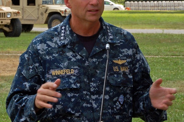 MUSCATATUCK URBAN TRAINING CENTER, Ind. - Adm. James Winnefeld Jr., commander of North American Aerospace Defense Command and U.S. Northern Command, answers questions during a press conference July 16 about the Vibrant Response 10.2 exercise at the Muscatatuck Urban Training Center in Butlerville, Ind. Vibrant Response is a national emergency response exercise involving more than 3,500 personnel participating in a scenario in which a nuclear weapon detonates in a major U.S. city. The exercise is facilitated by U.S. Army North's Joint Task Force - 51, headquartered in San Antonio.