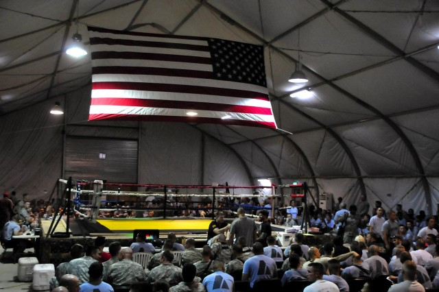 An audience of about 1,000 gathers for 'Fight Night' to begin at COB Adder's Memorial Hall July 4. Fight Night is a way of bringing an Ultimate Fighting Championship experience to COB Adder.