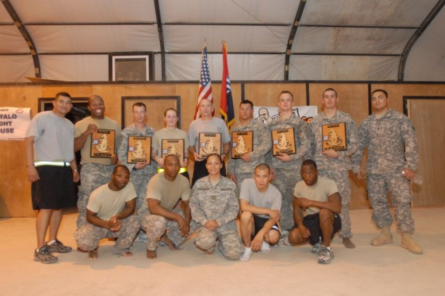 Soldiers of the 3rd Heavy Brigade Combat Team, 3rd Infantry Division pose with their awards following the finals of the brigade's combatives tournament July 10 at Contingency Operating Site Kalsu, Iraq.  The Soldiers pictured will go on to represent 3rd HBCT and the 3rd Inf. Div. in the All-Army Combatives Tournament later this year.