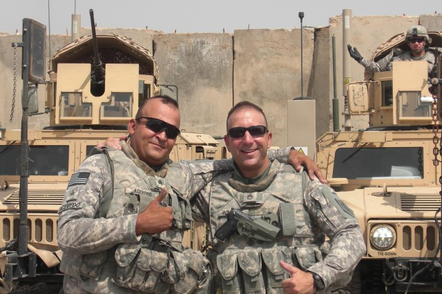 Staff Sgt. Peter Winston (right) and Sgt. Daniel Acevedo, both with Security Company, Division Headquarters and Headquarters Battalion, 1st Infantry Division,  prior to a mission to the Basra governor's palace. Winston deployed to Iraq with the 'Big Red One' after a 19 year break in service.
