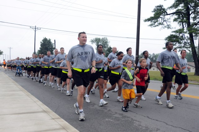 Soldiers of the 3d Sustainment Command (Expeditionary) participated in fun run during the units Family Day, held on Friday, July 9. The fun run was part of a day that included several events for Soldiers and Family members to include card and board games, relay races and even tug of war matches between platoons.  Kid's activities included limbo contests, an inflatable castle and the water balloon toss. (U.S. Army photo by Sgt. Michael Behlin)