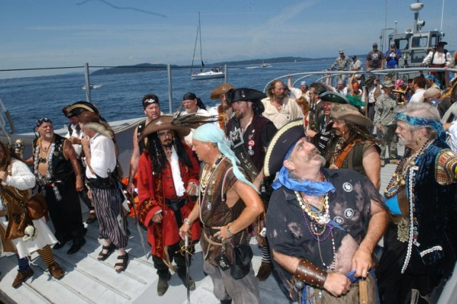 The Seafair Pirates, a motley crew of scallywags and swashbucklers, on board the Army's LCM-8560,  prepare to storm Alki beach and kick off Seattle's annual Seafair, the region's largest summer festival. The pirates have been part of the festival since 1949.