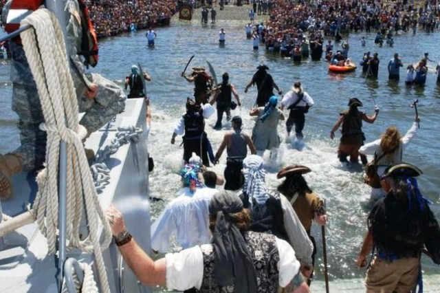 The Seafair Pirates storm Alki Beach in Seattle with the help of the 175th Transportation Company, a U.S. Army Reserve unit from Tacoma, Wash. The pirates have been part of Seattle's Seafair celebration since 1949.