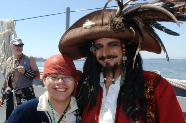 Captain Kidd XVI, also known as Mike Knowlton, captain of the Seafair Pirates, and Joseph Rackham, also known as Happy Joe Rackham, an honorary pirate stand together on the deck of the Army's LCM-8560 July 10. Happy Joe, whose desire to become a pirate was granted by the Make-A-Wish Foundation, was knighted as Captain Kidd, Jr., something never done in the history of Seafair.