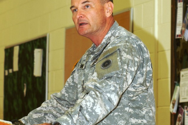 Col. Martin Spann, the 311th Expeditionary Sustainment Command operations officer, addresses members of the 909th Human Resources Company during their mobilization ceremony July 16 in Bothell, Wash.