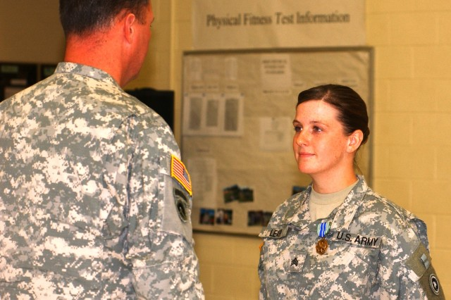 Sgt. Marybeth Leary of the 909th Human Resources Company, Bothell, Wash., is presented with the Army Achievement Medal by Col. Frederick Maiocco, commander of the 654th Regional Support Group, during the 909th's mobilization ceremony July 16.