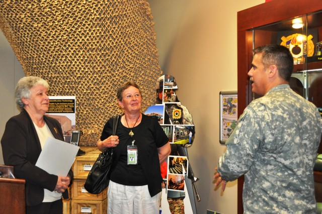 JMC retiree honorees check out the JMC display room along with Command Sgt. Maj. David Puig.