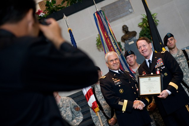 Chief of Staff of the Army Gen. George W. Casey Jr. presents an award to Lt. Gen. Buster Hagenbeck, 57th Superintendent of U.S. Military Academy, at West Point, N.Y., July 19, 2010.