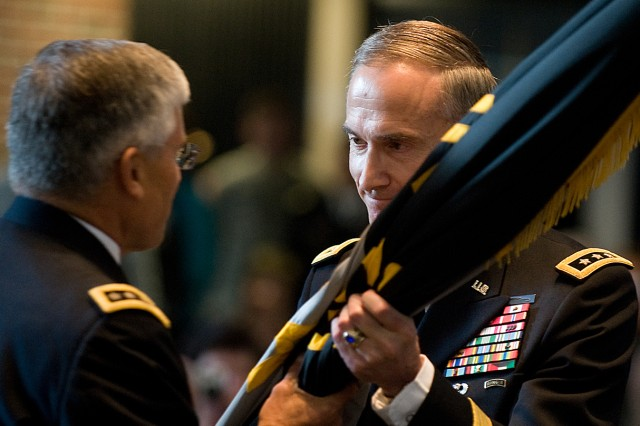 Lt. Gen. David H. Huntoon Jr., 58th Superintendent of U.S. Military Academy,  receives the unit's colors from the Chief of Staff of the Army, Gen. George W. Casey Jr., as part of the change of command ceremony at West Point, N.Y., July 19, 2010.