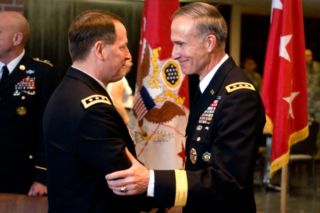 Lt. Gen. Buster Hagenbeck, 57th Superintendent of U.S. Military Academy, shakes hands with Lt. Gen. David H. Huntoon Jr., 58th Superintendent of USMA, at the conclusion of the change of command ceremony in West Point, N.Y., July 19, 2010.