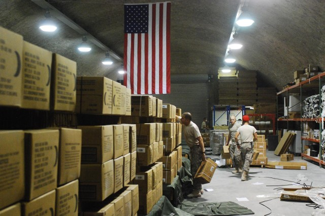 Soldiers from the 824th Quartermaster Company, deployed to Qatar and assigned to the 1st Sustainment Brigade, secure a cargo delivery system package of Meals Ready to Eat. The 824th recently broke the theater airdrop record with 1,649,278 pounds of cargo dropped into theater.