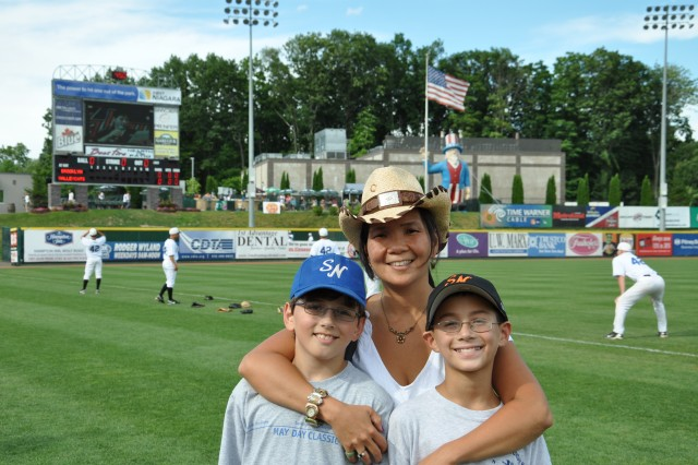 Karol-Anne Madulka, from the Army's Benet Labs, stands with sons prior to the Arsenal Appreciation Night at the ValleyCats.