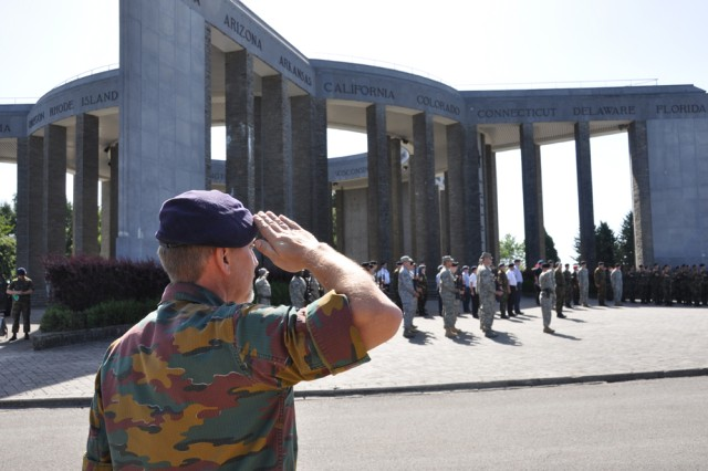 CHIEVRES, Belgium - A Belgian soldier salutes during the 60th anniversary of the Mardasson Memorial July 16 near Bastogne, Belgium.