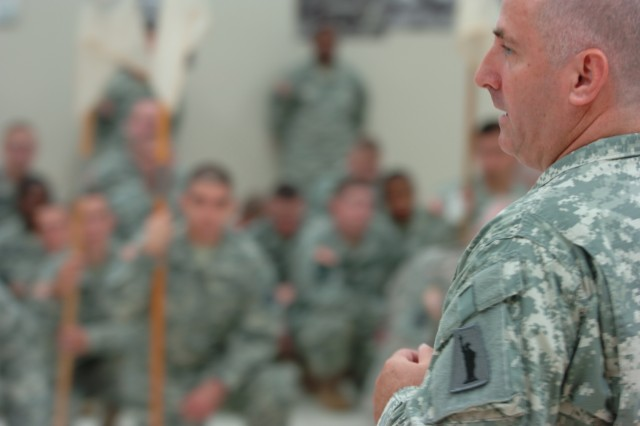 FORT DEVENS, Mass. (July 20, 2010) - Col. Stephen Falcone, outgoing commander of the 655th Regional Support Group, addresses his Soldiers for the last time as their commander. He is now the new commander of the 77th Sustainment Brigade out of Fort Dix, N.J. Falcone, of Hudson, Mass., is being replaced at the 655th RSG by Col. Ernest Erlandson, of Brookville, Pa., (U.S. Army photo by Spc. Michael Bender, 316th ESC Public Affairs Office)