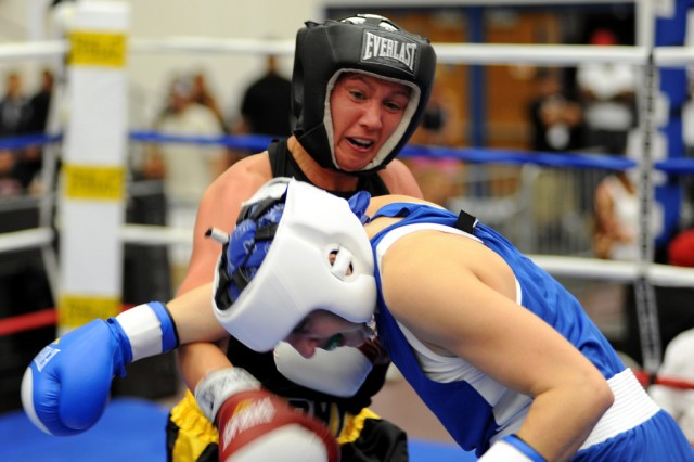U.S. Army World Class Athlete Program boxer Spc. Carrie Barry wins the bronze medal in the women's lightweight division of the 2010 U.S. National Boxing Championships at the U.S. Olympic Training Center in Colorado Springs.