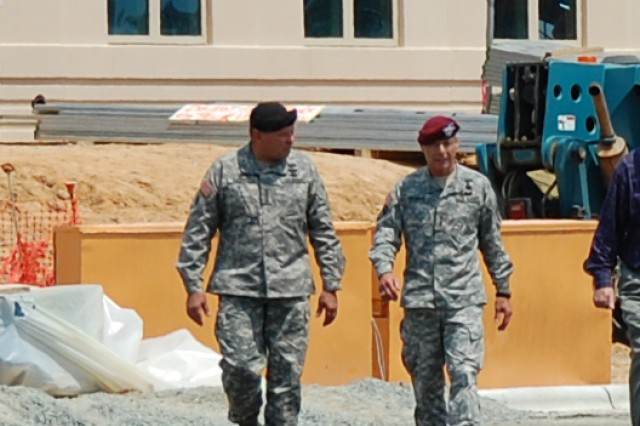 (L-R)  General James D. Thurman, commanding general, U.S. Army Forces Command and Lt. Gen. Frank G. Helmick, commanding general, XVIII Airborne Corps and Fort Bragg, leave the site of the new FORSCOM/U.S. Army Reserve Command combined headquarters construction project at Fort Bragg, N.C., following a tour of the complex, July 15, 2010.  FORSCOM and USARC are relocating from Fort McPherson, Ga., which is scheduled for closure not later than Sept. 15, 2011 under the provisions of the Base Realignment and Closure legislation of 2005.