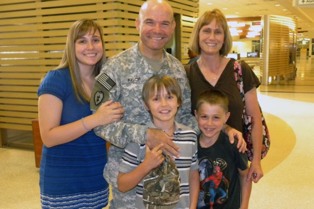 Lt. Col. Arpad Kisch, 533rd FEST-M, Fort Knox, Ky. and his family at the Louisville International Airport. Kisch was part of a team that deployed to conduct engineering operations in support of Operation Iraqi Freedom.