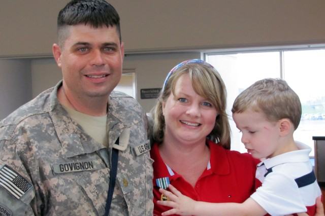 Maj. Michael Govignon, 533rd FEST-M, Fort Knox, Ky. and his family at the Louisville International Airport. Govignon was part of a team that deployed to conduct engineering operations in support of Operation Iraqi Freedom.