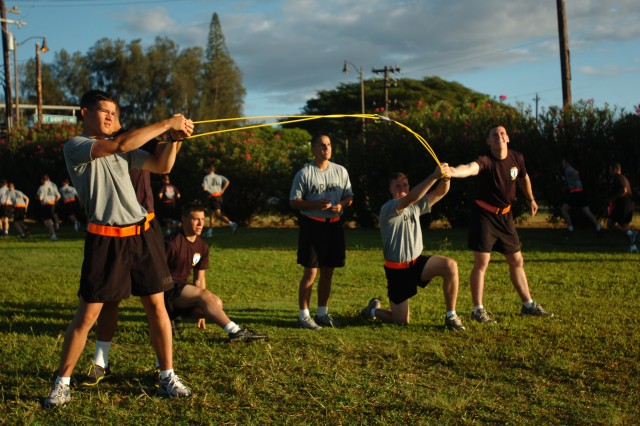 U.S. Army cadets and their sponsors work together during the water balloon launch event of the physical fitness training session with 25th Infantry Division senior leadership at Sills Field on Schofield Barracks, Hawaii, July 20. The cadets and their sponsors were challenged to a series of physical trials during the morning's training session alongside division's leadership. (U.S. Army photo by Spc. Jesus J. Aranda, 25th Infantry Division Public Affairs Office)