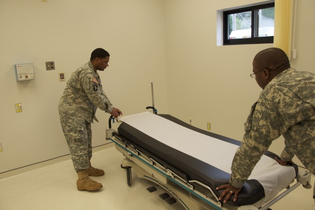 Sgt. Damon Rembert (left) and Capt. Brian Green move a gurney into the new family care wing that is part of the $4.5 million upgrade to Casey Garrison's U.S. Army Health Clinic.