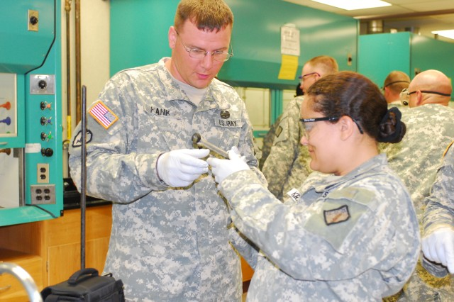 Spc. Holly Kremer and Spc. Walter Hanks of 172nd Chem. Co., 84th EOD complete a chemistry distillation July 7 on the K-State campus.