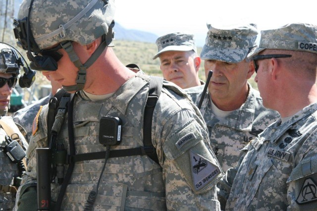 Vice Chief of Staff of the Army Gen. Peter Chiarelli (second from right) looks at a Soldier equipped with the Land Warrior system. Land Warrior provides a Soldier with a navigation and communication system that the Soldier can use to better communicate and coordinate with other Soldiers.
