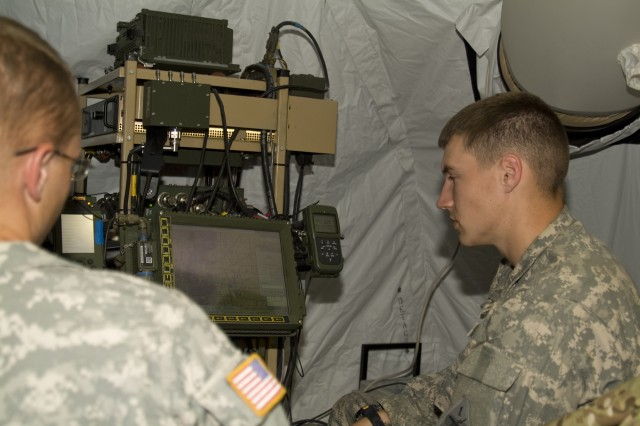 Pvt. Russell Kirkwood from the 5th Brigade Combat Team, 1st Armored Division operates a Network Integration Kit at the Forward Operating Base located near Orogrande Base Camp on White Sands Missile Range. The NIK is one of the systems that act as a node to create the network used by the Soldiers during the exercise.