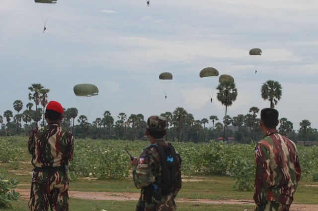 Royal Cambodian Armed Forces soldiers watch U.S. and Cambodian servicemembers during the friendship jump at Angkor Sentinel 2010.  Angkor Sentinel is a multinational training exercise supporting peace-support operations co-sponsored by the Royal Cambodian Armed Forces, U.S. Pacific Command and U.S. Army Pacific.