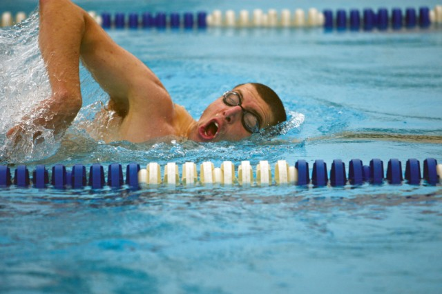 Ryan McPheeters, 563rd Medical Logistics Company at Camp Carroll, takes a quick breath during the 400-meter swim segment of the 8th Army Triathlon Championship at Casey Garrison's Hanson Field House July 17. McPheeters finished second in the men's junior division.
