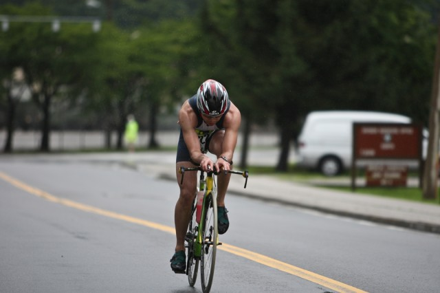 Christopher Tung, 4th Support Detachment (Rear Operations Center) at Camp Henry, bolts toward the finish line of the 20-kilometer bike segment of the triathlon. Tung finished third in the junior men's division.
