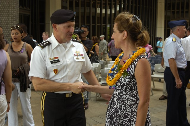 "Lieutenant Gen. Benjamin R. Mixon, commanding general, U.S. Army Pacific, thanks artist Judie Feingold on behalf of Army units serving on Hawaii for her crafted artwork, the ""Lost Heroes Art Quilt,"" during a ceremony honoring the sacrifices of military service members from each state at the Hawaii State Capitol Rotunda, Honolulu, July 21. The quilt honors the sacrifice of fallen military service members of each of the Nation's 50 states with cutout photo portraits of the fallen heroes as children clad in ""G.I. Joe"" cloth jackets to represent the timeless spirit of the memory of their families. Feingold created the piece through an effort to honor the memories of fallen military heroes through a more personal form. ""This work seeks to bring our bravest Americans to life by allowing viewers a glimpse into each of their personalities, plans and dreams,"" said Feingold. (U.S. Army photo by Spc. Jesus J. Aranda, 25th Infantry Division Public Affairs Office)"