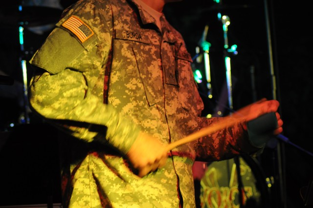 """Pvt. George Burda, Company D, 1st Battalion, 61st Infantry Regiment, is one of three Soldiers invited to perform onstage with the band """"Voice"""" during a Christian concert Sunday at the Solomon Center."""