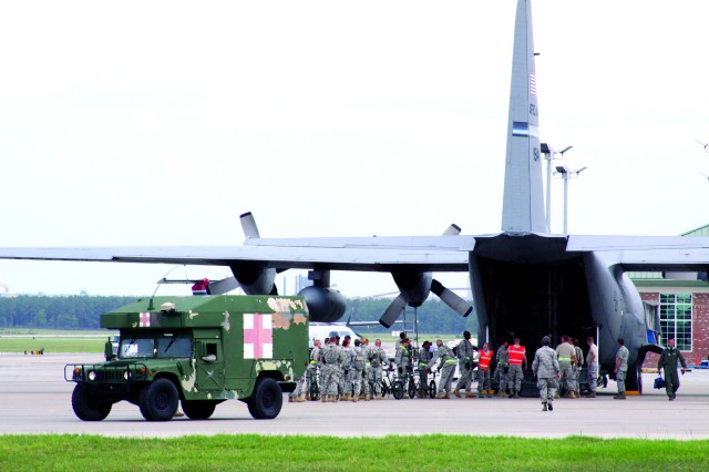 Patients in stable condition are loaded on an Air Force C-130 Medivac aircraft at Bush Field, Ga., as if it were a real flight mission out of a theater hospital to a military medical facility during DoD's largest medical training exercise, Global Medic, held July 15-19 at Fort Gordon, Ga.