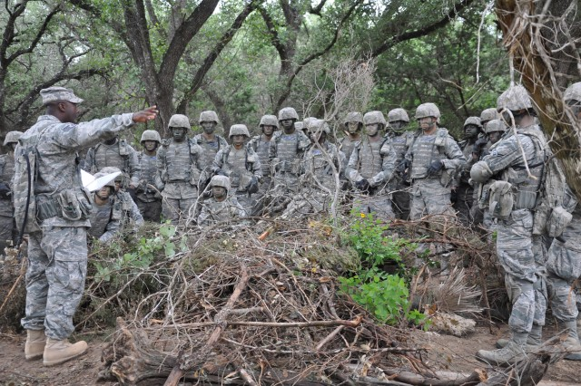 Students from the 343rd Training Squadron, Detachment 1, Apprentice Security Forces Course, receive instructions from Security Forces Instructor, Staff Sgt. Colby Benjamin, on fire control measures and defensive fighting positions. The U.S. Air Force is the second largest tenant on Camp Bullis.