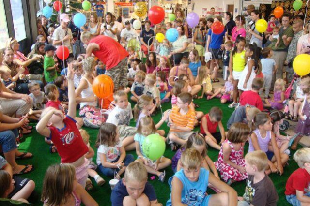 Soldiers and their Families gather inside the Fort Rucker Post Exchange for a McClelland's Critters show during the 115th anniversary celebration of the Air Force Exchange Service, July 15.