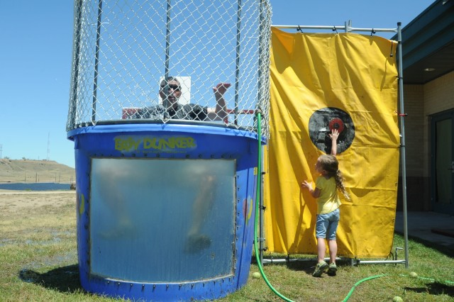FORT CARSON, Colo.-Lt. Col. Donald K. Wols, Group Support Battalion, 10th Special Forces Group (Airborne) commander, takes a swim in the dunk tank during Family Day July 16.